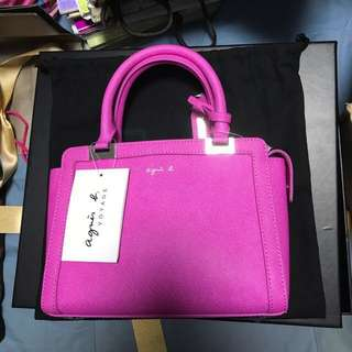 Agnes b small office sling bag in sweet pink