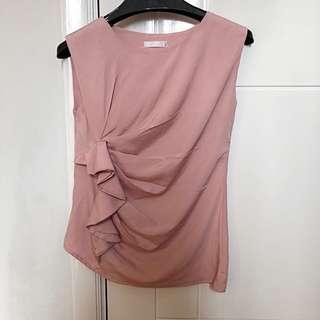 Light pink sleeveless ruffled top