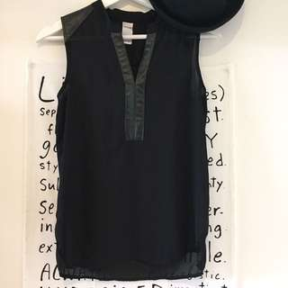 Black top with faux leather trim