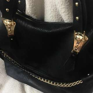 Black leather bag with gold chain