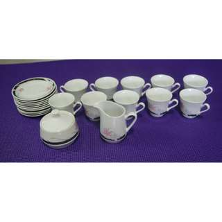 10 sets of cups and saucers, plus sugar and milk containers