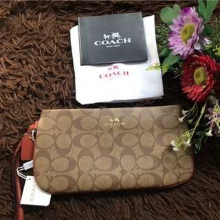 Authentic Coach Wristlet with card and dust bag (Serial number tag inside for authenticity)
