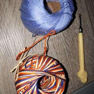 Metal hook with balls of strings