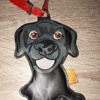 Dog leather bag tag some torn on the tag handle but u can sew it