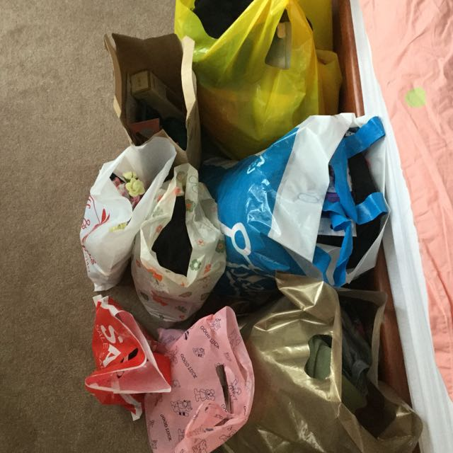Bags of clothes and others