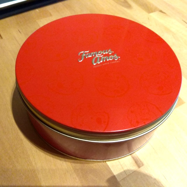 Empty Famous Amos Biscuit Tin