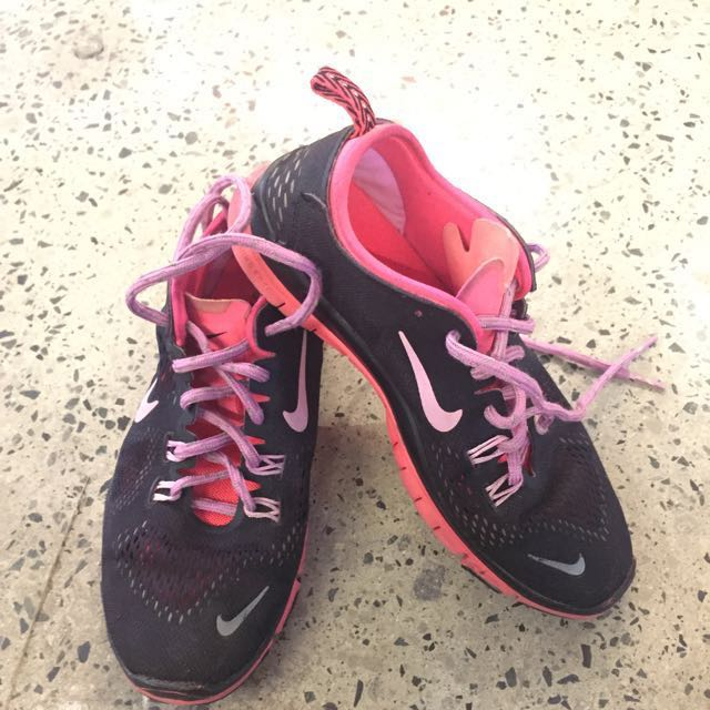 well-loved black and pink rubber shoes