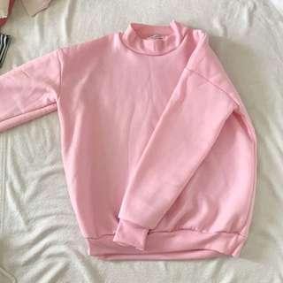 pink mockneck sweater