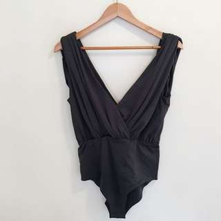 Plunge neck bodysuit with draped backward