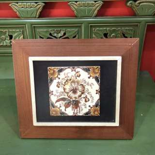Vintage tile in wooden frame