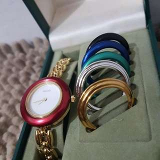 Gucci watch with bezel