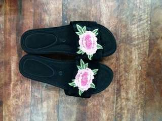 Black slip on with floral patch