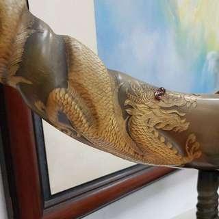 Buffalo horn with dragon sculpture