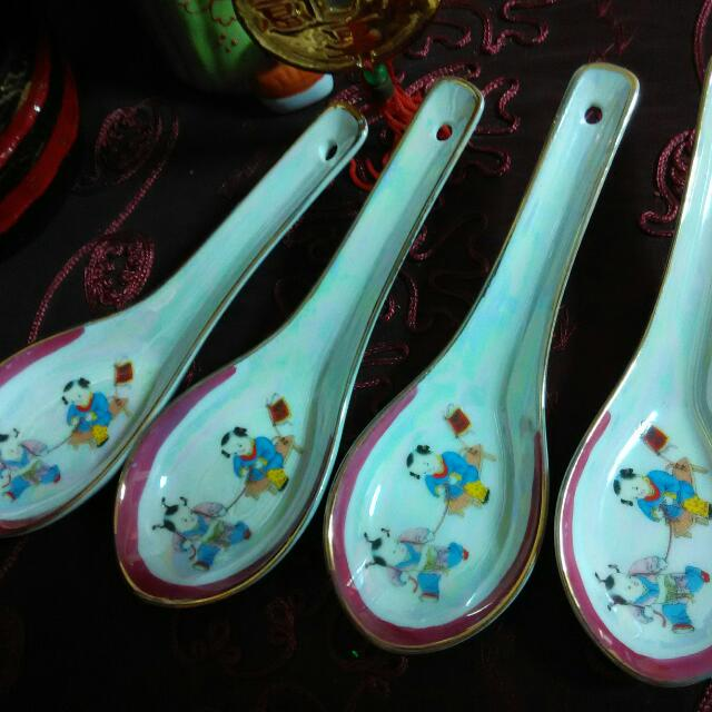 Porcelain spoons with handrawn children