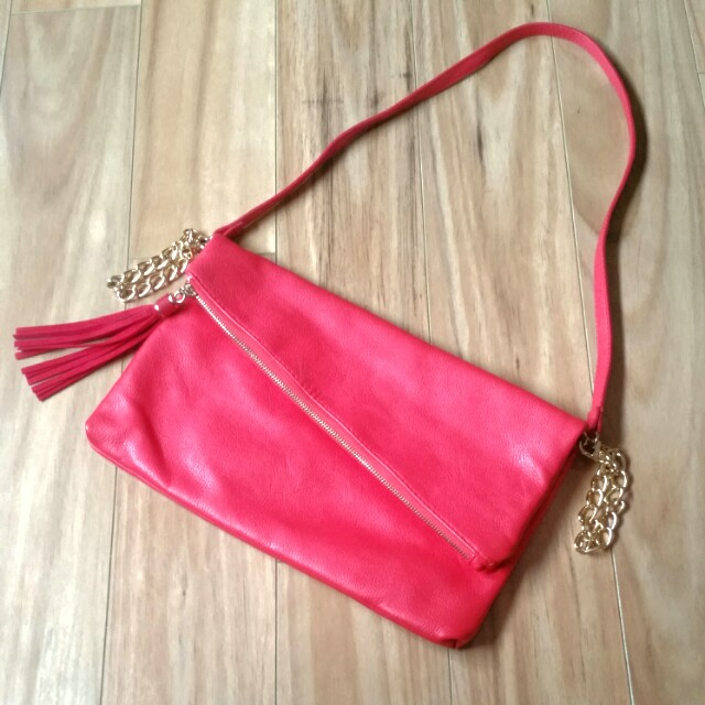 Red cross body bag gold chain
