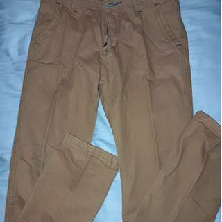 Long pants trousers for boys. Colour Brown