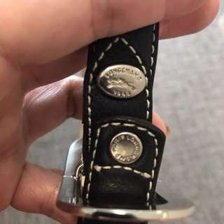 Longchamp ladies belt.  Pure black full leather with white thread trimming.  Bought in Paris.