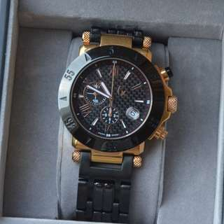 Guess Collection (Gc) Gold/Black Watch (quartz) in original box. Seldom used. Collection/Vintage watch.