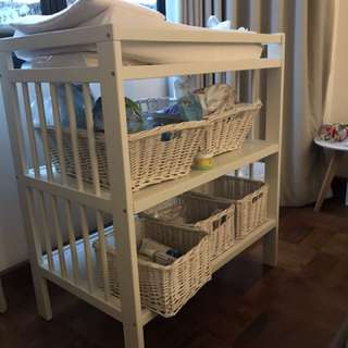 White changing table with baskets