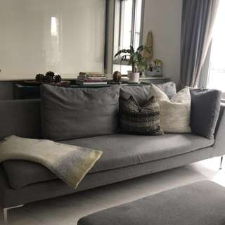 Sofa - Fabric with sofa cushions.