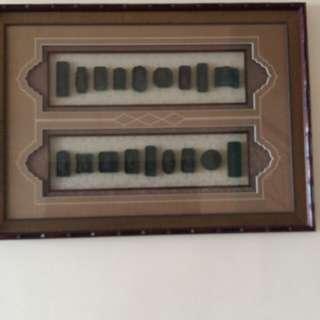 Unique framed artwork of 18 arahants (lohan) on ink slabs.