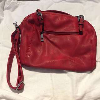 Red handbag with multiple pockets