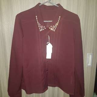 Red collared blouse with pearls on collar