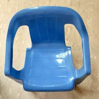 Plastic chair. Good for kids & small size adults too.