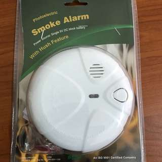 Photo electric smoke Alarm with hush features