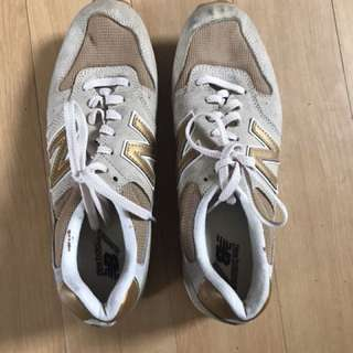 New Balance limited edition gold sneakers