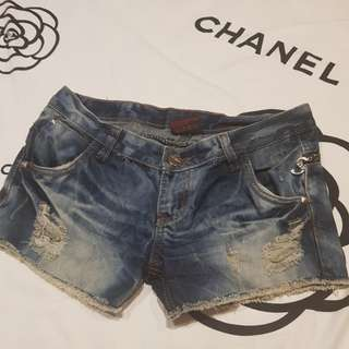 Ripped denim shorts with studded detail