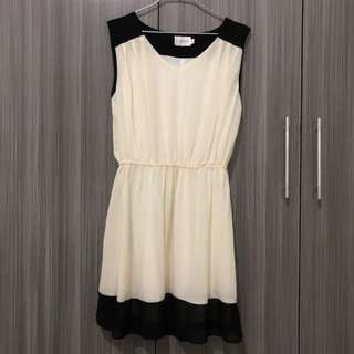 Elegant black and cream dress
