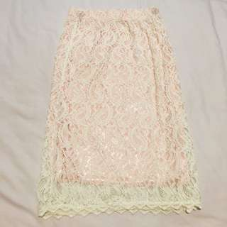 Cream coloured lace skirt with pink lining