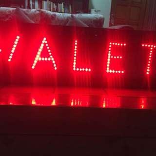 LED sign saying Valet,