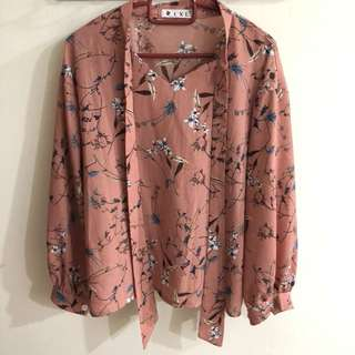 Long sleeved pink floral blouse