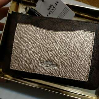 Brand new Coach pouch in gift box