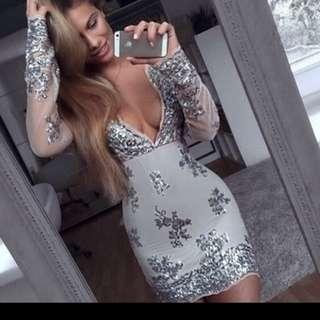 Looking for tis V neck sequin dress