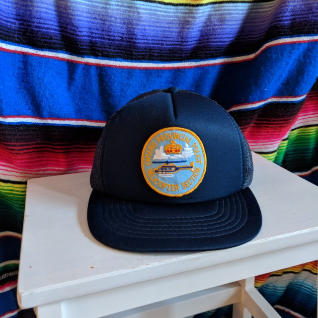 Vintage 'Ontario Provincial Police Helicopter Section' mesh trucker hat.
