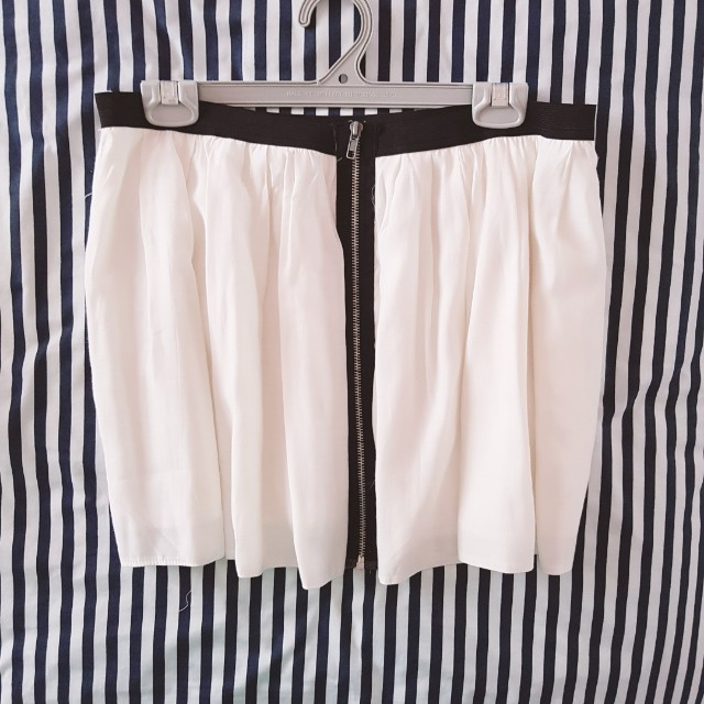 White skirt with zipper down the front