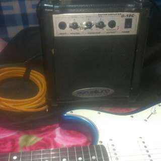 Electric guitar w/ amplifier ,bag and cable.