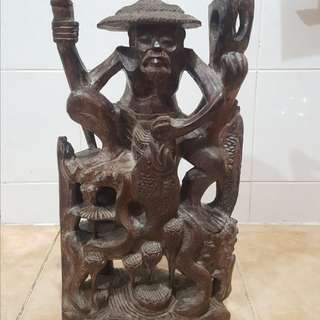 Antique Wooden fisherman statue
