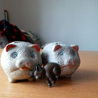 2 piggy...money box. And one metal paper clip
