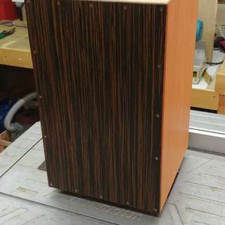 Custom cajon, bass ported. Ebony front, oak veneer body.