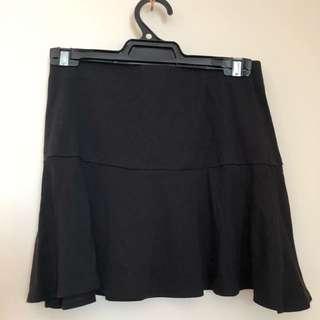 Black elasticised mini work skirt