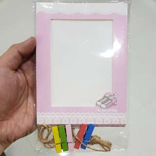 Photo frame with clips