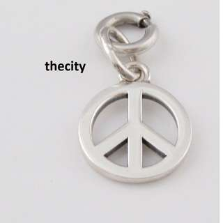AUTHENTIC TIFFANY & CO. PEACE CHARM PENDANT - IN SILVER