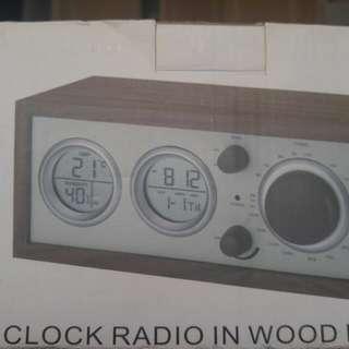 Elegant clock radio with wooden casing