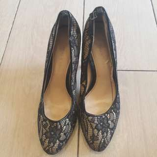 Black shoes with flower pattern