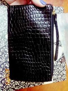 黑色亮皮化妝包