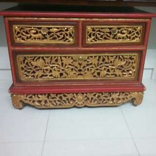 Peranakan red and gold chest of drawers with handcarved flower motifs